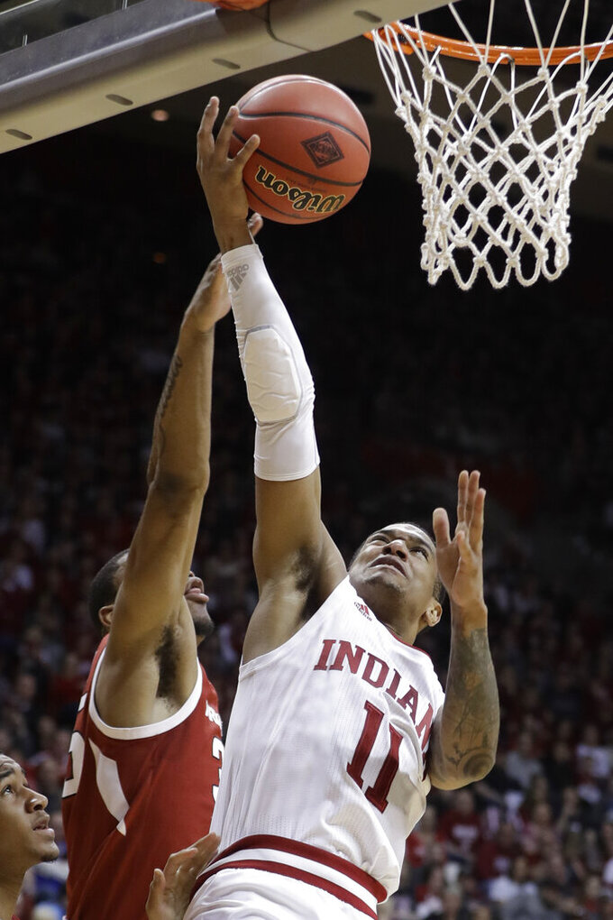 Indiana's Devonte Green (11) puts up a shot against Arkansas's Reggie Chaney during the second half in the second round of the NIT college basketball tournament, Saturday, March 23, 2019, in Bloomington, Ind. Indiana won 63-60. (AP Photo/Darron Cummings)