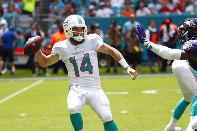 Miami Dolphins quarterback Ryan Fitzpatrick (14) looks to pass, during the first half at an NFL football game against the Baltimore Ravens, Sunday, Sept. 8, 2019, in Miami Gardens, Fla. (AP Photo/Wilfredo Lee)