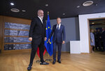 European Council President Donald Tusk, right, greets Albanian Prime Minister Edi Rama prior to a meeting at the European Council building in Brussels, Wednesday, Oct. 16, 2019. (AP Photo/Virginia Mayo, Pool)
