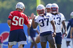 New England Patriots running back Damien Harris (37) greets quarterback Mac Jones (50) during an NFL football practice, Friday, July 30, 2021, in Foxborough, Mass. (AP Photo/Elise Amendola)