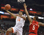 FILE - In this Feb. 23, 2019, file photo, Virginia guard De'Andre Hunter (12) attempts a shot over the reach of Louisville center Malik Williams (5) during the first half of an NCAA college basketball game, in Louisville, Ky. Hunter was named to the AP All-ACC team, Tuesday, March 12, 2019.(AP Photo/Timothy D. Easley, File)