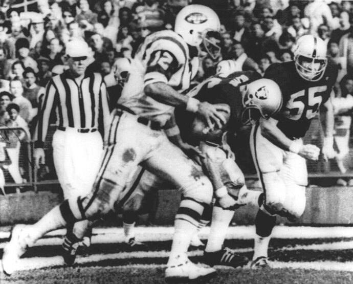 FILE - In this Nov. 17, 1968, file photo, New York Jets' quarterback Joe Namath (12) sweeps around the right side past Oakland Raider defenders Ralph Oliver (56) and Dan Conners (55) to score from the one-yard line during the second quarter of a football game at Oakland Coliseum in Oakland, Calif. The Jets were leading 32-29 when the childrens  classic
