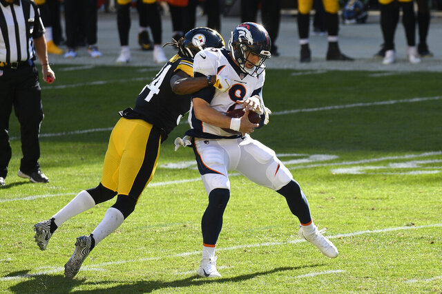 Denver Broncos quarterback Jeff Driskel, right, is sacked by Pittsburgh Steelers strong safety Terrell Edmunds, left, during the second half of an NFL football game in Pittsburgh, Sunday, Sept. 20, 2020. (AP Photo/Don Wright)