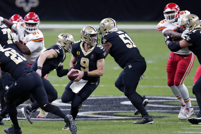 New Orleans Saints quarterback Drew Brees (9) drops back in the first half of an NFL football game against the Kansas City Chiefs in New Orleans, Sunday, Dec. 20, 2020. (AP Photo/Brett Duke)