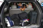 Migrants who are lodging at the AMAR migrant shelter get ready for a trip to the border in the Pastor's vehicle, to apply for asylum in the United States side, from Nuevo Laredo, Mexico, Wednesday, July 17, 2019. Asylum-seekers grappled to understand what a new U.S. policy that all but eliminates refugee claims by Central Americans and many others meant for their bids to find a better life in America amid a chaos of rumors, confusion and fear. (AP Photo/Marco Ugarte)