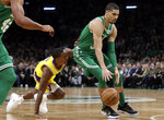 Boston Celtics forward Jayson Tatum dribbles the ball past Los Angeles Lakers guard Rajon Rondo in the first quarter of an NBA basketball game, Thursday, Feb. 7, 2019, in Boston. (AP Photo/Elise Amendola)