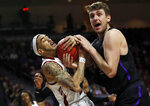 New Mexico State guard Trevelin Queen (20) and Grand Canyon's Alessandro Lever vie for a rebound during the first half of an NCAA college basketball game for the Western Athletic Conference men's tournament championship Saturday, March 16, 2019, in Las Vegas. (AP Photo/Steve Marcus)