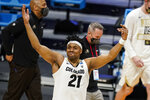 Colorado forward Evan Battey (21) celebrates at a time out against Georgetown in the first half of a first-round game in the NCAA men's college basketball tournament at Hinkle Fieldhouse in Indianapolis, Saturday, March 20, 2021. (AP Photo/Michael Conroy)