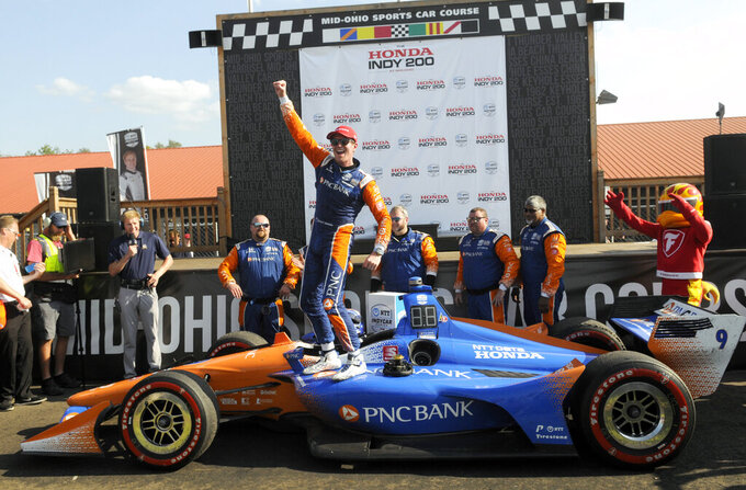 Scott Dixon celebrates winning the IndyCar Series auto race at Mid-Ohio Sports Car Course, Sunday, July 28, 2019 in Lexington, Ohio. (AP Photo/Tom E. Puskar)