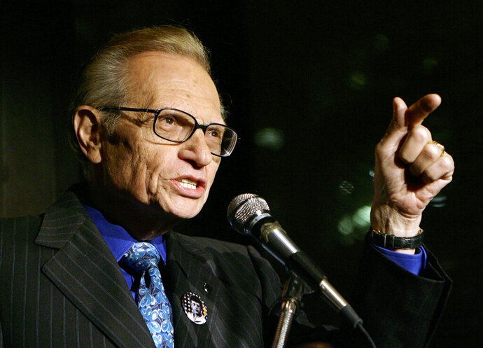FILE - In this April 18, 2007 file photo, Larry King speaks to guests at a party held by CNN, celebrating King's fifty years of broadcasting in New York.  King, who interviewed presidents, movie stars and ordinary Joes during a half-century in broadcasting, has died at age 87. Ora Media, the studio and network he co-founded, tweeted that King died Saturday, Jan. 23, 2021 morning at Cedars-Sinai Medical Center in Los Angeles.  ( AP Photo/Stuart Ramson, File)