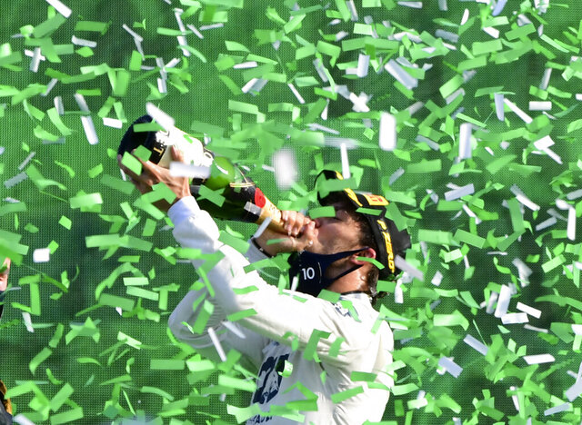 AlfaTauri driver Pierre Gasly of France celebrates on the podium after winning the Formula One Grand Prix at the Monza racetrack in Monza, Italy, Sunday, Sept.6 , 2020. (Jennifer Lorenzini, Pool via AP)