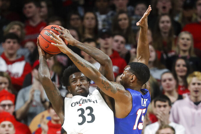 Cincinnati's Nysier Brooks (33) and SMU's Isiaha Mike (15) compete for a rebound during the first half of an NCAA college basketball game Saturday, Feb. 2, 2019, in Cincinnati. (AP Photo/John Minchillo)