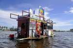 Jay's Sand Bar Floating BBQ, serves pork nachos and alligator bites to hungry boaters and bikini-wearing partiers on the sandbar in Ft. Lauderdale, Fla., on Saturday, Oct. 10, 2020. (Mike Stocker/South Florida Sun-Sentinel via AP)