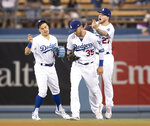 Los Angeles Dodgers left fielder Enrique Hernandez, left, right fielder Cody Bellinger, and center fielder Alex Verdugo, right, celebrate after the Dodgers defeated the Chicago Cubs 7-3 in a baseball game in Los Angeles, Thursday, June 13, 2019. (AP Photo/Kyusung Gong)