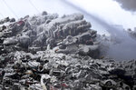 Icy covered junker autos lie in a heap as firefighters on Wednesday morning remained on the scene of a fire that has been burning for more than 24 hours at the Northern Metal Recycling plant, Feb. 19, 2020, in Becker, Minn. (David Joles/Star Tribune via AP)
