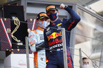 Red Bull driver Max Verstappen of the Netherlands celebrates after winning the Monaco Grand Prix at the Monaco racetrack, in Monaco, Sunday, May 23, 2021. (Sebastien Nogier, Pool via AP)