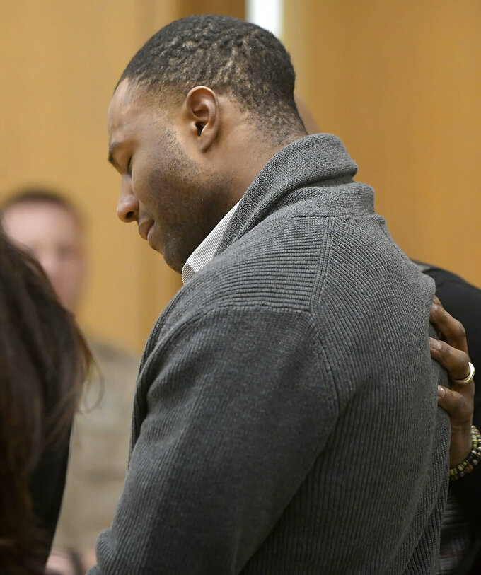 Torrey Green reacts as a jury finds him guilty of eight charges including five counts of rape and a charge sexual battery in connection to reports from six women accusing him of sexual assault while he was a football player at Utah State University, Friday, Jan.18, 2019 in Brigham City, Utah. (Eli Lucero/Herald Journal via AP, Pool)