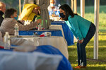 Sara Gideon, right, a Democratic candidate for U.S. Senate, speaks with an attendee at a