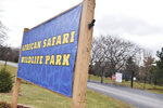 The gate is locked and the African Safari Wildlife Park is closed, Friday, Nov. 29, 2019, after a barn fire Thursday at the park killed at least 10 animals according to officials in Port Clinton, Ohio. Three bongos, three giraffes, three red river hogs and a springbok housed in the barn were thought to be dead, fire officials said. The cause of the fire is under investigation. No humans were injured.(AP Photo/David Richard)
