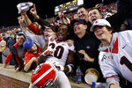 Georgia defensive back J.R. Reed (20) celebrates with fans after the team defeated Auburn 21-14 in an NCAA college football game, Saturday, Nov. 16, 2019, in Auburn, Ala. (AP Photo/Butch Dill)