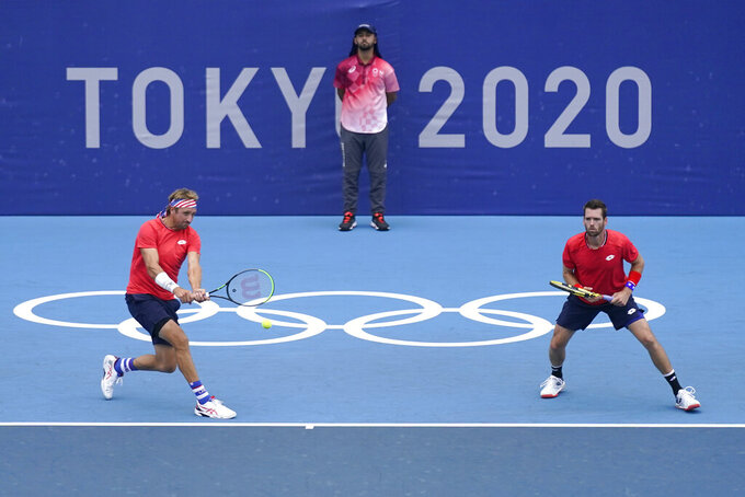 The United States doubles team of Tennys Sandgren, left, and Austin Krajicek play during the men's doubles bronze medal match of the tennis competition at the 2020 Summer Olympics, Friday, July 30, 2021, in Tokyo, Japan. (AP Photo/Seth Wenig)