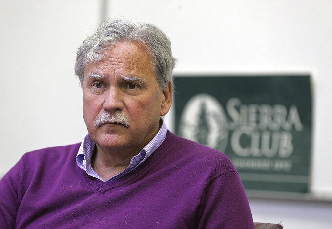 In this Jan. 17, 2017, photo, Jeff Tittel, director of environmental organization Sierra Club's New Jersey chapter, discusses concerns about Exelon Corp.'s Oyster Creek Generating Station during an interview at the chapter's office in Trenton, N.J. On Wednesday, March 24, 2021, Tittel announced his retirement as director of the New Jersey Sierra Club, which he led for 23 years. As one of the state's highest-profile environmentalists, Tittel battled government agencies and private industry over issues including pollution, development and public access to beaches and waterways. (Tanya Breen/The Asbury Park Press via AP)