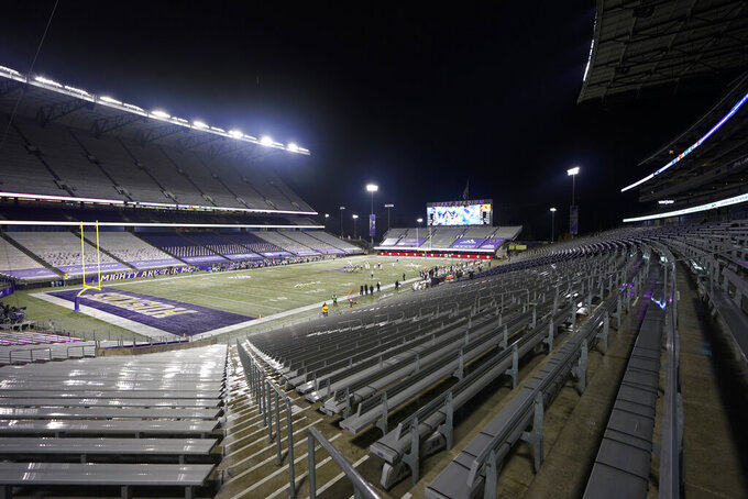 Empty seats are shown at Husky Stadium during the second half of an NCAA college football game between Washington and Oregon State, Saturday, Nov. 14, 2020, in Seattle. No fans were in attendance due to the COVID-19 pandemic. Washington won 27-21. (AP Photo/Ted S. Warren)