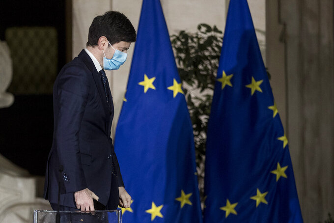 Italian Health Minister Roberto Speranza arrives to meet the media and illustrate the government's new measures to curb the spread of COVID-19 in Rome, Tuesday, March 2, 2021. The first anti-pandemic decree from Italy's new premier, Mario Draghi, tightens measures governing school attendance while easing restrictions on museums, theaters and cinemas. (Roberto Monaldo/LaPresse via AP)