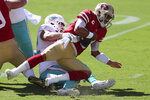 Miami Dolphins defensive end Zach Sieler, left, sacks San Francisco 49ers quarterback Jimmy Garoppolo during the first half of an NFL football game in Santa Clara, Calif., Sunday, Oct. 11, 2020. (AP Photo/Jed Jacobsohn)