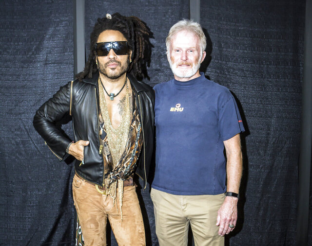In this image provided by Mark Kelton, Lenny Kravitz, the headliner at this years Spookstock concert poses with Army Gen. Tony Thomas, former commander of U.S. Special Operations Command, at the annual Spookstock event, While many Washington insiders haven't heard of it, the annual charitable event, held each year in an undisclosed Washington location, has become a centerpiece for Washington's tight-knit intelligence-military special operations community. It has raised millions to fund higher education for the children of CIA field officers and special operations soldiers killed on duty. (Mark Kelton via AP)