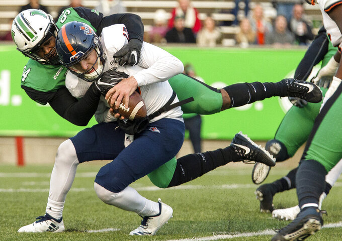FILE - In this Nov. 17, 2018, file photo, Marshall's Channing Hames (94) sacks UTSA quarterback Bryce Rivers during an NCAA college football game in Huntington, W.Va. Channing Hames and Omari Cobb lead a defense that didn't allow any individual to rush for 100 yards last season. (Sholten Singer/The Herald-Dispatch via AP, File)