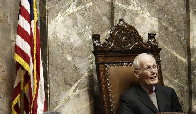FILE - In this Jan. 14, 2015, file photo, former state attorney Slade Gorton, who is also a former U.S. senator, listens as former Gov. Dan Evans speaks in the Washington state Senate chamber in Olympia Wash. Gorton, a three-term U.S. senator who was the rare Republican in Democratic Washington state, died Wednesday, Aug. 19, 2020. He was 92. (AP Photo/Rachel La Corte)