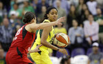 Seattle Storm's Jordin Canada, right, tries to drive past Las Vegas Aces' Kelsey Plum during the first half of a WNBA basketball game Friday, July 19, 2019, in Seattle. (AP Photo/Elaine Thompson)
