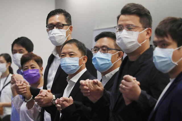 Hong Kong Democratic Party lawmakers from left; Ted Hui Chi-fung, Helena Wong Pik-wan, Lam Cheuk-ting, Wu Chi-wai, James To, Andrew Wan Siu-kin and Roy Kwong Chun-yu attend a press conference in Hong Kong, Thursday, Aug. 20, 2020. Lawmakers from Hong Kong's largest pro-democracy party, the Democratic Party, said Thursday they planned to hold a poll and debate to determine whether they will continue serving another year in the city's legislature, following a postponement of elections due to the coronavirus outbreak. (AP Photo/Kin Cheung)