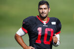 San Francisco 49ers quarterback Jimmy Garoppolo runs during a combined NFL football training camp with the Denver Broncos at the Broncos' headquarters Friday, Aug. 16, 2019, in Englewood, Colo. (AP Photo/David Zalubowski)