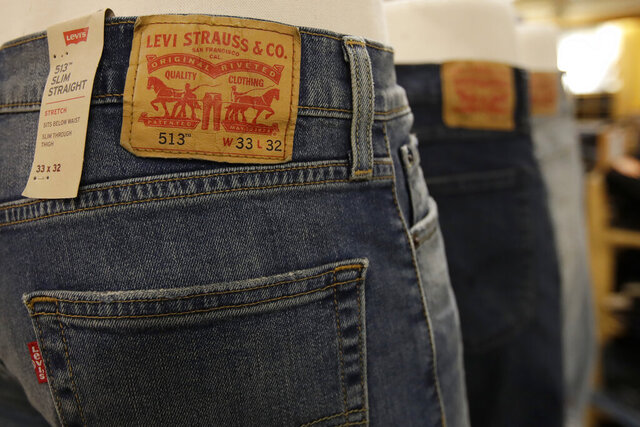 FILE - In this Nov. 29, 2019, file photo, Levi's jeans are displayed at a Kohl's store in Colma, Calif. Levi's says it will cut 700 office jobs, or about 15% of its worldwide corporate workforce, as the jeans seller deals with a sharp drop in sales due to the coronavirus pandemic. (AP Photo/Jeff Chiu, File)