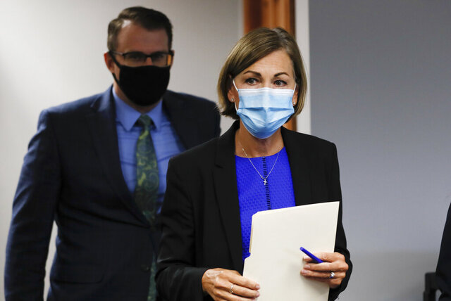 Iowa Gov. Kim Reynolds arrives to update the state's response to the coronavirus outbreak during a news conference, Tuesday, July 7, 2020, in Urbandale, Iowa. (AP Photo/Charlie Neibergall)