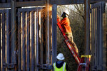 FILE - Crews construct a section of border wall in San Bernardino National Wildlife Refuge, Tuesday, Dec. 8, 2020, in Douglas, Ariz. President Biden on Wednesday ordered a