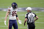 Chicago Bears tight end Cole Kmet (85) questions the referee in the first half of an NFL wild-card playoff football game against the New Orleans Saints in New Orleans, Sunday, Jan. 10, 2021. (AP Photo/Brett Duke)