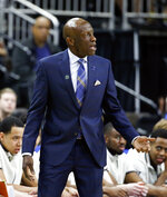 Yale head coach James Jones talks to players on the court during the first half of a first round men's college basketball game against LSU in the NCAA Tournament in Jacksonville, Fla., Thursday, March 21, 2019. (AP Photo/Stephen B. Morton)