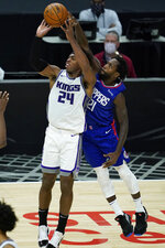 Los Angeles Clippers guard Patrick Beverley (21) deflects a shot by Sacramento Kings guard Buddy Hield (24) during the third quarter of an NBA basketball game Wednesday, Jan. 20, 2021, in Los Angeles. (AP Photo/Ashley Landis)