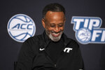 Virginia Tech head coach Kenny Brooks laughs during NCAA college basketball Atlantic Coast Conference media day, Wednesday, Oct. 13, 2021, in Charlotte, N.C. (AP Photo/Matt Kelley)