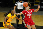 Ohio State guard Kateri Poole (5) passes around Iowa guard Tomi Taiwo, left, during the first half of an NCAA college basketball game, Wednesday, Jan. 13, 2021, in Iowa City, Iowa. (AP Photo/Charlie Neibergall)