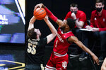 Indiana guard Al Durham (1) blocks the shot of Purdue guard Sasha Stefanovic (55) during the first half of an NCAA college basketball game in West Lafayette, Ind., Saturday, March 6, 2021. (AP Photo/Michael Conroy)