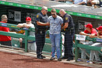 Police detain a man who walked across the field and approached Philadelphia Phillies' Brad Miller as he came to bat in the sixth inning of a baseball game against the Pittsburgh Pirates, Sunday, July 21, 2019, in Pittsburgh. The police took the man from the field and play continued. (AP Photo/Keith Srakocic)