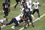 Hawaii running back Miles Reed (4) slips through the Nevada defense into the end zone for a touchdown during the second half of an NCAA college football game Saturday, Nov. 28, 2020, in Honolulu. (AP Photo/Marco Garcia)