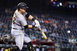 Pittsburgh Pirates' John Nogowski connects for a two-run home run against the Arizona Diamondbacks during the fifth inning of a baseball game Tuesday, July 20, 2021, in Phoenix. (AP Photo/Ross D. Franklin)
