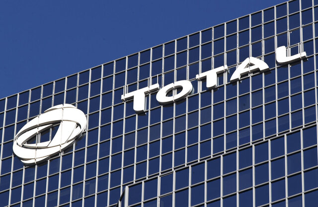 FILE - This Jan.11, 2016 file photo shows the logo of French oil giant Total SA on its headquarters at La Defense business district outside Paris. A partnership of French non-governmental organisations and over a dozen local authorities launched unprecedented legal action Tuesday against energy company Total, aimed at forcing it to drastically reduce its greenhouse gas emissions. (AP Photo/Michel Euler, File)