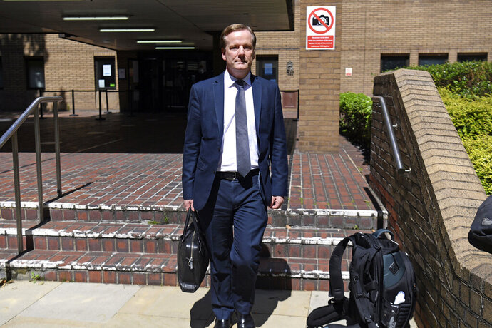 """Former Conservative MP Charlie Elphicke leaves Southwark Crown Court in London, Thursday, July 30, 2020. A former Conservative lawmaker in Britain was convicted Thursday of sexually assaulting two women a decade apart. A jury at London's Southwark Crown Court found Charlie Elphicke guilty of three counts of assault against two victims. One victim said Elphicke kissed her and groped her at his London home in 2007 before chasing her around his home chanting """"I'm a naughty Tory."""" (Kirsty O'Connor/PA via AP)"""