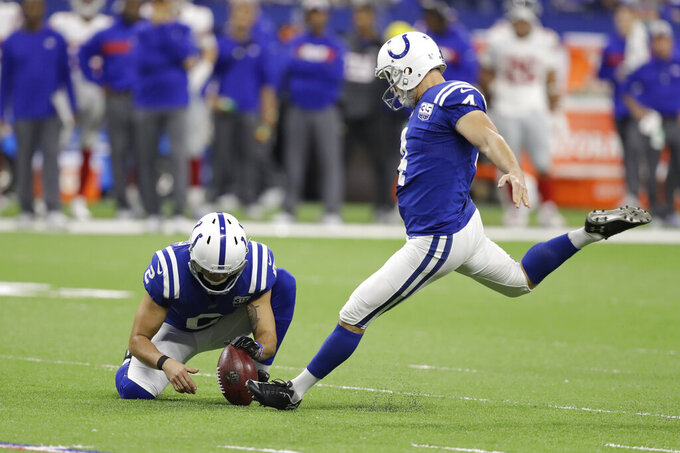 """FILE - In this Dec. 23, 2018, file photo, Indianapolis Colts' Adam Vinatieri (4) kicks a field goal from the hold of Rigoberto Sanchez during the second half of the team's NFL football game against the New York Giants in Indianapolis. The 48-year-old former Colts and New England Patriots star told former teammate and SiriusXM radio host Pat McAfee that he plans to retire. """"By Friday, if paperwork goes in, you heard it here first,"""" Vinatieri said. (AP Photo/Darron Cummings, File)"""